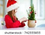 adorable little girl wearing... | Shutterstock . vector #742555855