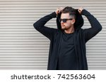 stylish young man with a beard... | Shutterstock . vector #742563604