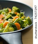 mixed  vegetables with fresh sprout in pan.  Selective focus - stock photo