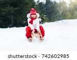 little girl enjoying a sleigh... | Shutterstock . vector #742602985