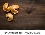 Small photo of Future prognostic with fortune cookie on wooden background top view mock-up