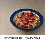 bowl of dry cereal on wooden...   Shutterstock . vector #742609015