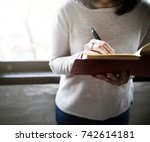 asian woman writing on a... | Shutterstock . vector #742614181