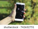 girl holding a broken smart... | Shutterstock . vector #742632751