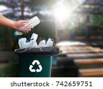 man hand putting plastic reuse  ... | Shutterstock . vector #742659751