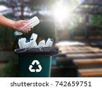 man hand putting plastic reuse  ... | Shutterstock . vector #742659751