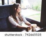 woman wearing glasses is...   Shutterstock . vector #742665535
