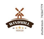 windmill logo vintage style.... | Shutterstock .eps vector #742667779