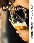 hand of bartender pouring a... | Shutterstock . vector #742672564