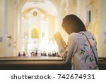 girl praying worship in a... | Shutterstock . vector #742674931