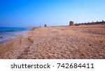 old mills on the beach | Shutterstock . vector #742684411