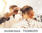 once in a barbershop. the young ... | Shutterstock . vector #742686205