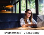woman sitting at laptop working ...   Shutterstock . vector #742689889