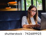 woman typing on laptop working...   Shutterstock . vector #742689925