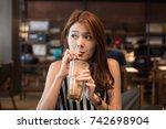 beautiful young asian woman... | Shutterstock . vector #742698904