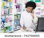 chemist writing on clipboard... | Shutterstock . vector #742700005
