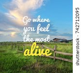Small photo of Inspirational motivation quote GO WHERE YOU FEEL THE MOST ALIVE on nature, paddy field,blue sky clouds,wooden fence background.