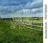 Small photo of Inspirational motivation quote DON'T LET YESTERDAY TAKE UP TOO MUCH OF TODAY on nature,paddy field,wooden fence,dramatic clouds background.