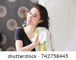 Small photo of Beautiful Young Female After Bath Applying Hair Oil.