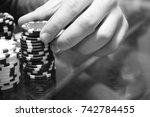 man's hand pick a chips. poker...   Shutterstock . vector #742784455