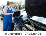 garage workers working on car... | Shutterstock . vector #742826401