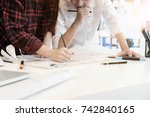 Small photo of Engineer discussing meeting for architectural project working with partner and engineering tools on workplace Planning Design Draw Teamwork.