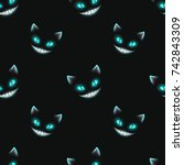 Stock vector seamless pattern with disappearing cat faces on black background cheshire cat texture vector 742843309