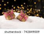 christmas gifts on snow  ligts...   Shutterstock . vector #742849009