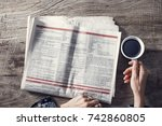 reading newspaper on desk | Shutterstock . vector #742860805