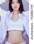 attractive sporty asian woman... | Shutterstock . vector #742882759