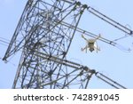 drone and transmission towers    Shutterstock . vector #742891045