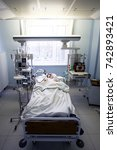 Small photo of 2017-10-25, Belarus, Grodno, Regional cardiac hospital. Emergency patient in critical state in intensive care department in emergency room with myocardial infarction, Editorial content