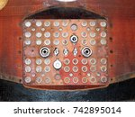 Small photo of vintage electrical connecting panel on a soyuz capsule with reentry burns and scorch marks on red metal