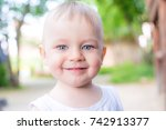 one year old blond smiling boy | Shutterstock . vector #742913377
