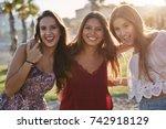 three pretty girls standing... | Shutterstock . vector #742918129