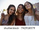 three beautiful women standing... | Shutterstock . vector #742918579