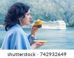 beautiful brunette woman drinks ...   Shutterstock . vector #742932649