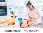 woman cooking and slicing... | Shutterstock . vector #742951924