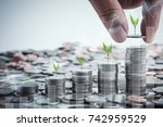 male hand putting coins with... | Shutterstock . vector #742959529