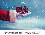 Santa Claus Hand Holding  Trai...