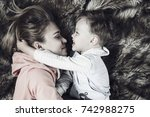 mom and son playing together on ... | Shutterstock . vector #742988275