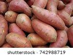 sweet potatoes piled for market   Shutterstock . vector #742988719