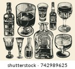 set of stemware and bottles .... | Shutterstock .eps vector #742989625