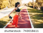 woman runner listening music... | Shutterstock . vector #743018611