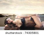 beautiful woman in bikini lying