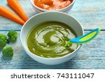 bowl with baby food on wooden... | Shutterstock . vector #743111047