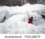 man shuffling snow in parking... | Shutterstock . vector #743118079