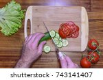 cutting cucumber and tomato on... | Shutterstock . vector #743141407