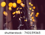 glowing fairy lights with bokeh | Shutterstock . vector #743159365