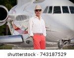 handsome man standing next to a ...   Shutterstock . vector #743187529